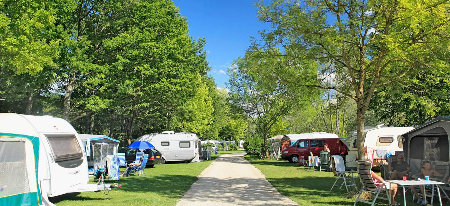 Campsite alley with tent and caravan
