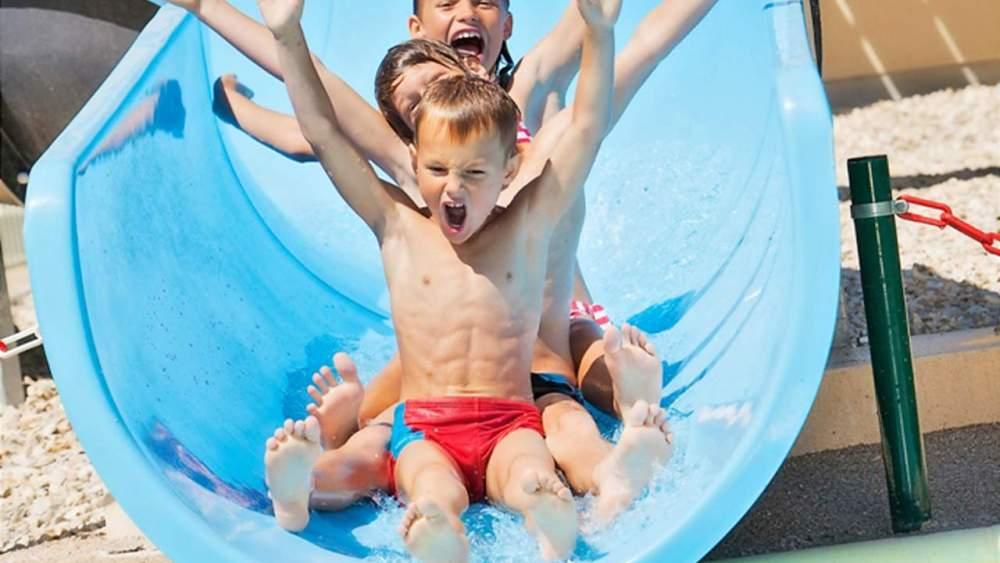 Children down the water slide