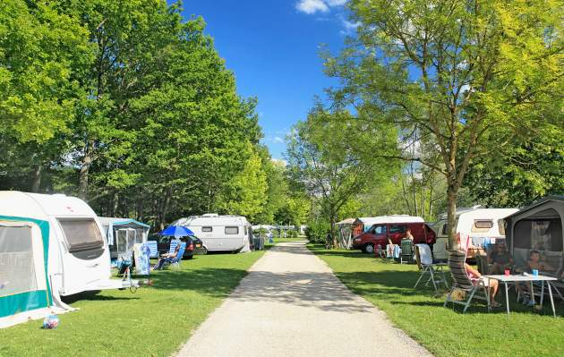 Campsite alley with tents and caravans